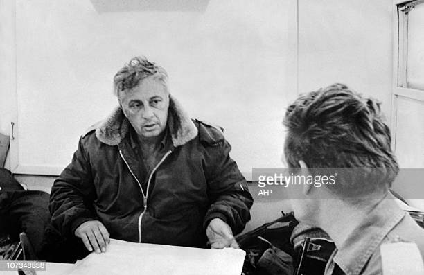 Israeli General Ariel Sharon commander in chief of Tsahal forces at the west bank of the Suez canal confers with a military 12 November 1973...