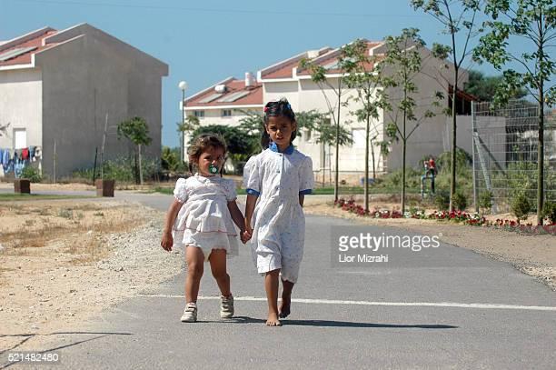 Israeli girls walk in the Gaza Strip settlement of Netzarim Wednesday 6 July 2005