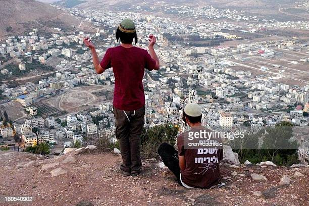 CONTENT] Israeli hilltop youth third generation settlers praying in towards Joseph`s tomb now in area A under Palestinian control