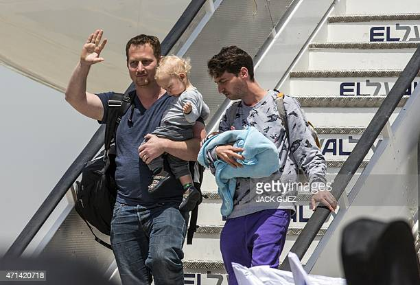 Israeli homosexual men one of them carrying a baby born to a surrogate mother in Nepal disembark a plane at Ben Gurion airport near Tel Aviv on April...