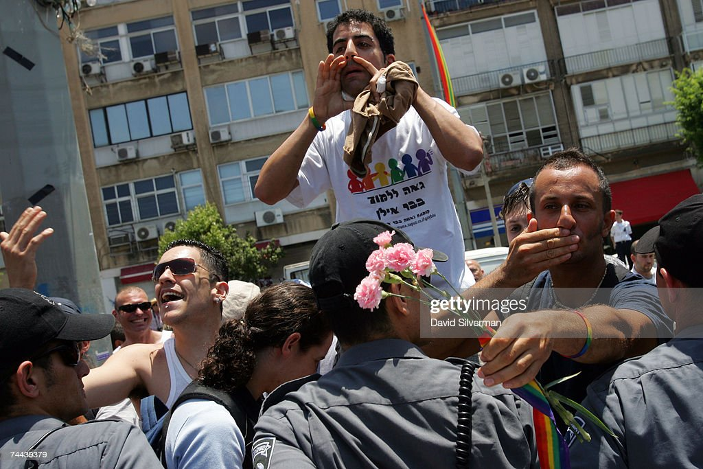 Israeli homosexuals lean over an Israeli police line to taunt religious protestors during the annual Gay Pride rally, on June 8, 2007 Tel Aviv, Israel's most cosmopolitan city. Thousands of alternative lifestyle Israelis took advantage of the mild summer weather to celebrate sexual freedom amidst calls from Jewish, Muslim and Christian religious leaders to ban a similar rally in Jerusalem later this month.
