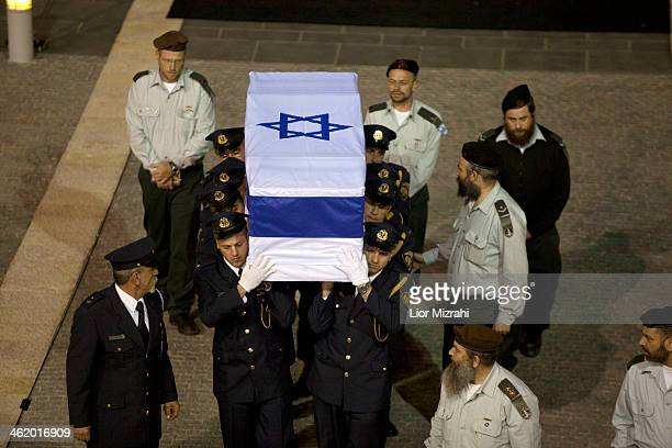 Israeli honour guards carry the coffin of former Israeli Prime Minister Ariel Sharon into the Knesset Israel's Parliament on January 12 2014 in...