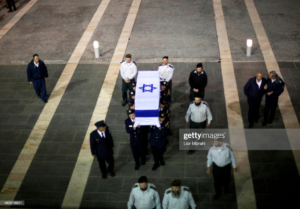 Israeli honour guards carry the coffin of former Israeli Prime Minister Ariel Sharon into the Knesset, Israel's Parliament, on January 12, 2014 in Jerusalem, Israel. A memorial service will be held tomorrow followed by a funeral near Sycamore Farm, the former prime minister's residence. Former PM Ariel Sharon's died yesterday after suffering from multiple organ failure. Sharon, 85, was hospitalised in Tel Hashomer hospital near Tel Aviv and has been in a coma since January 4, 2006.