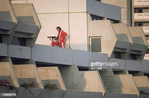 Israeli Hostage Crisis 1972 Summer Olympics Police officer with gun rifle on rooftop during crisis at 31 Connollystrasse in Olympic Village 11...