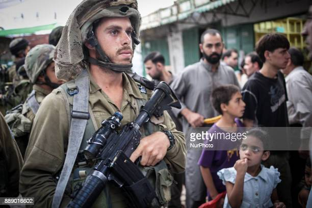 Israeli IDF soldiers in Palestinian part of Hebron In 2014 Israel launched military operation on 8 July 2014 in the Hamasruled Gaza Strip Following...