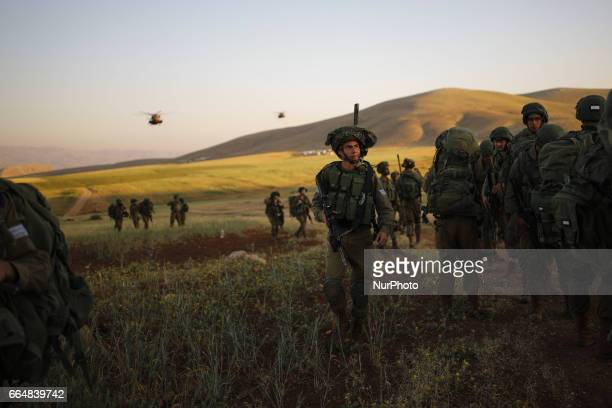 Israeli infantry soldiers from the Haruv battalion of the Kfir Brigade take part in a counterterrorism drill with helicopters that takes place in...