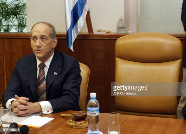 Israeli interim Prime Minister Ehud Olmert chairs the weekly cabinet meeting in his Jerusalem offices with the chair of former Prime Minister Ariel...