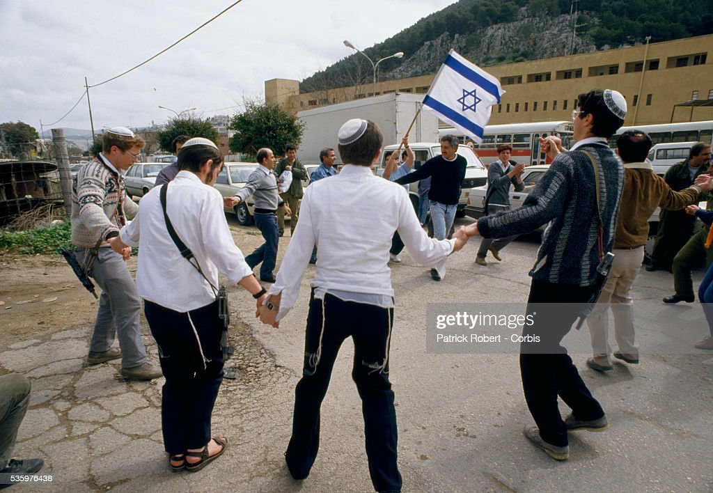 Israeli Jews celebrate Purim and perform the settlers dance during the Palestinian uprising. Violence broke out after rebel Israeli and Palestinian fighters protested in the disputed territory of West Bank during the first Intifada.