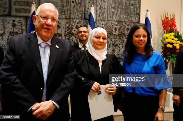 Israeli Justice Minister Ayelet Shaked and Israeli President Reuven Rivlin pose for a photo with Israeli Muslim Hana Khatib the first woman in Israel...