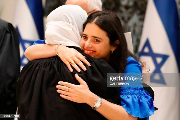 Israeli Justice Minister Ayelet Shaked hugs Israeli Muslim Hana Khatib the first woman in Israel to be appointed by an Israeli justice committee to...
