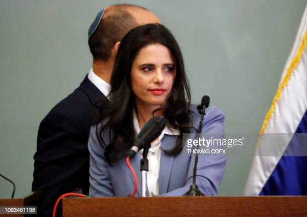 Israeli Justice Minister Ayelet Shaked is seen at the podium as she gives a statement at the Knesset in Jerusalem on November 19 with Education...