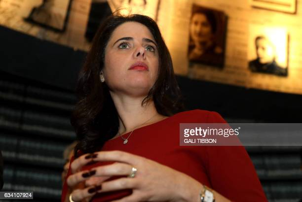 Israeli Justice Minister Ayelet Shaked looks at pictures of Jewish Holocaust victims on February 7 at the Hall of Names during his visit to the Yad...