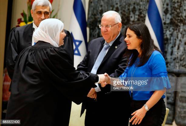 Israeli Justice Minister Ayelet Shaked shakes hands with Israeli Muslim Hana Khatib the first woman in Israel to be appointed by an Israeli justice...