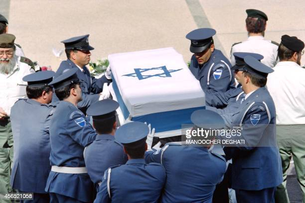 Israeli Knesset honorguards carry the coffin of assassinated Israeli Premier Yitzhak Rabin outside the Knesset shortly before the funeral of the...