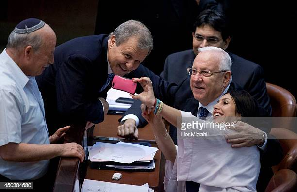 Israeli Knesset members and candidates Reuven Rivlin and Meir Shitrit take a selfie during the second round of presidential election at the Knesset,...