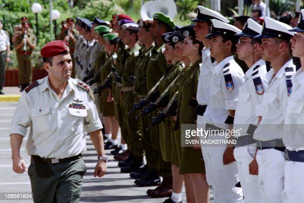 Israeli Labor party leader and new army chief of staff of the Israeli Defense Forces General Ehud Barak reviews troops from different units of the...