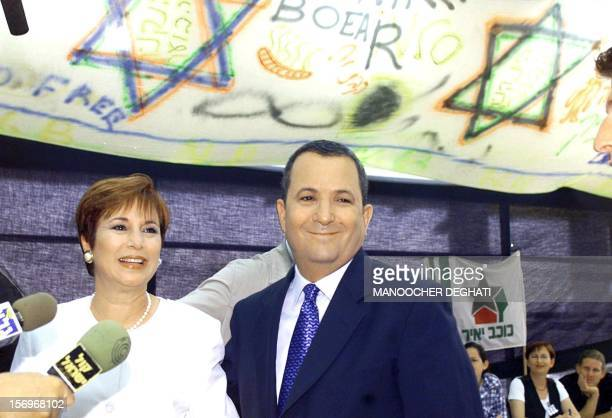 Israeli Labor party leader Ehud Barak and his wife Nava talk to the press after casting their ballot in Kokhav Yair 17 May 1999 during Israel's...