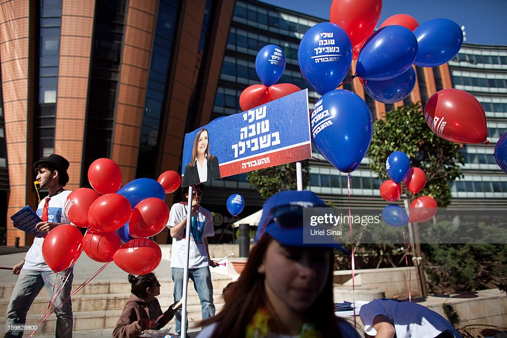 Israeli Labor party leader Shelly Yachimovich's supporters campaign on January 21, 2013 in Tel Aviv, Israel. The Israeli general election will be held on January 22.