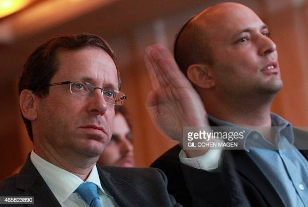 Israeli Labour Party leader and coleader of the Zionist Union list for the upcoming general election Isaac Herzog gestures next to Economy Minister...