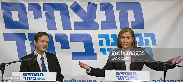 Israeli Labour Party leader Isaac Herzog looks on as former justice minister and HaTnuah party leader Tzipi Livni speaks during a press conference in...