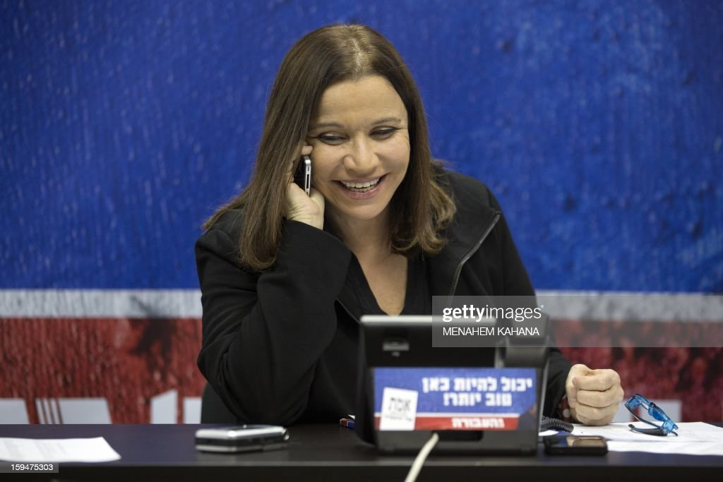 Israeli Labour party's leader Shelly Yachimovich speaks on the phone with supporters as part of her campaign for the general elections for the country's 19th Knesset on January 14, 2013 at a shopping mall in Tel Aviv. Israeli election will be held on January 22.