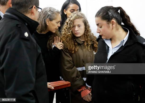 Israeli lawyer Gaby Lasky speaks with her client sixteenyearsold Ahed Tamimi before she stands for a hearing in the military court at Ofer military...
