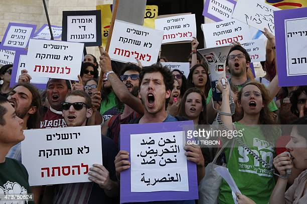 Israeli left wing activists take part in a demonstration against racism and what they call the 'march of hate' referring to the 'flag march' which...