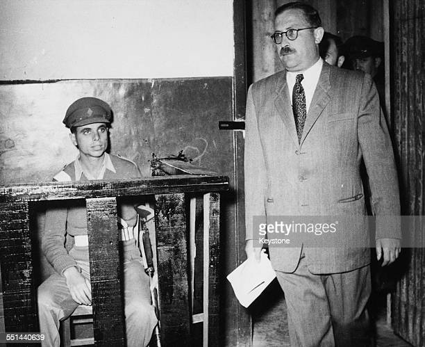 Israeli Lehi freedom fighter and politician Nathan Friedman YellinMor walking in to court on trial for terrorism in Acre Israel December 13th 1948