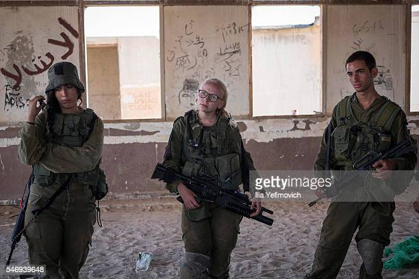 Israeli male and female combat soldiers of the Bardales battalion take part in a long day of practise in a heavy fog on July 13 2016 in Nitzana...