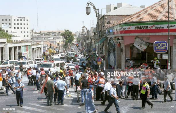 Israeli medics and volunteers treat the injured at the site of a Palestinian suicide bombing August 9 2001 in Jerusalem Israel At least 18 people...