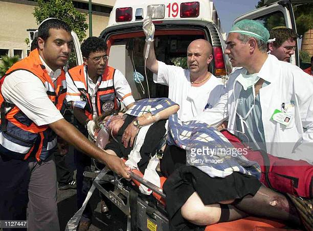 Israeli medics evacuate a wounded Jewish woman to Meir Hospital July 16 2002 in Kfar Saba Israel She was wounded in a Palestinian attack on a...