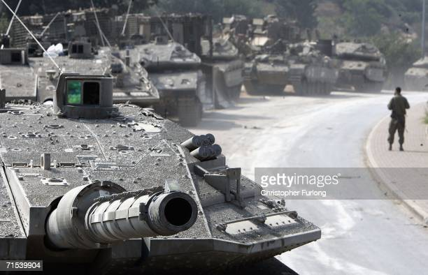 Israeli Merkava tanks and armour wait in a holding area near to the IsraeliLebanon border as forces move deeper into Lebanon to root out Hezbollah...