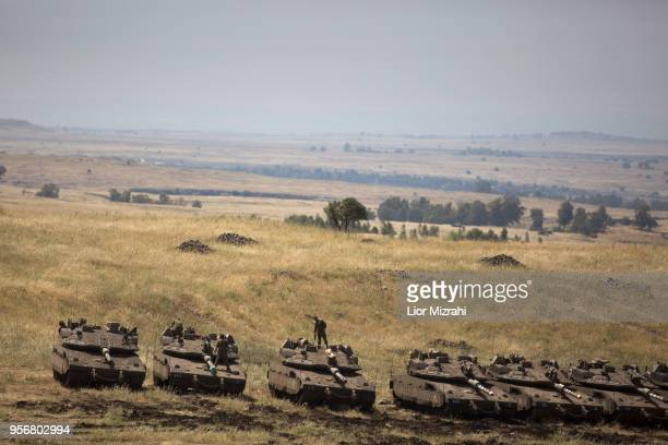 Israeli Merkava tanks are deployed near the IsraeliSyrian border on May 10 2018in the Israeliannexed Golan Heights Some 20 rockets were fired at...