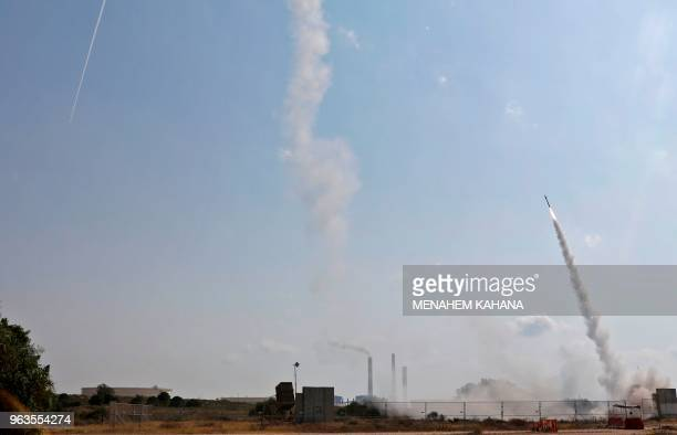Israeli military launch a missile from the Iron Dome air defence system, designed to intercept and destroy incoming short-range rockets and artillery...