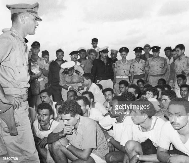 Israeli military officers with Egyptian prisoners of war from the Egyptian destroyer Ibrahim El Awal which surrendered to the Israelis during the...