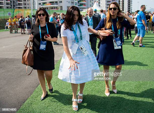Israeli Minister of Culture and Sport Miri Regev regains balance after almost tripping during a welcoming ceremony at the Athletes' Village ahead of...