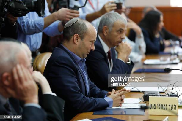 Israeli ministers of education Naftali Bennett and finance Moshe Kahlon attend the weekly cabinet meeting in Jerusalem on November 18 2018 Israeli...