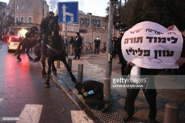 Israeli mounted policemen disperse ultraOrthodox Jews during a protest against Israeli army conscription in the centre of Jerusalem on March 20 2017...
