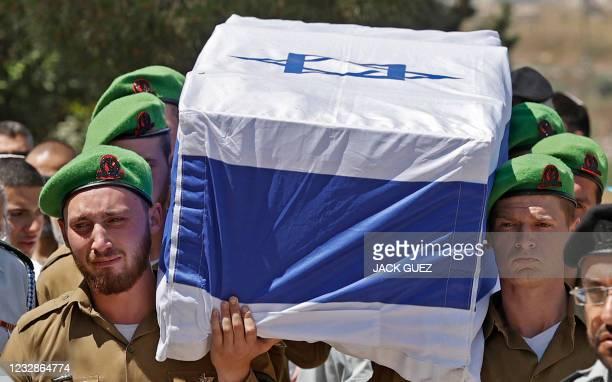 Israeli mourners attend the funeral of Israeli soldier Omer Tabib in Elyakim in northern Israel, on May 13, 2021. - Tabib was killed when Palestinian...