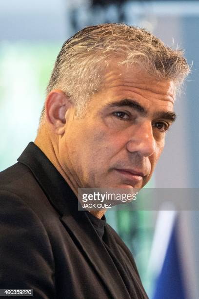 Israeli MP and chairperson of centreright Yesh Atid party Yair Lapid speaks during a meeting with female members of his party on December 12 2014 in...