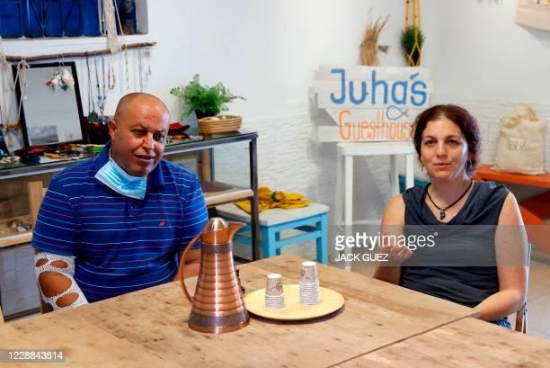 "Israeli Naama Goldman-Shwartz and Arab-Israeli Ahmad ""Juha"" Jorban speak to AFP at Juha's Guesthouse that they run together, in the coastal village..."