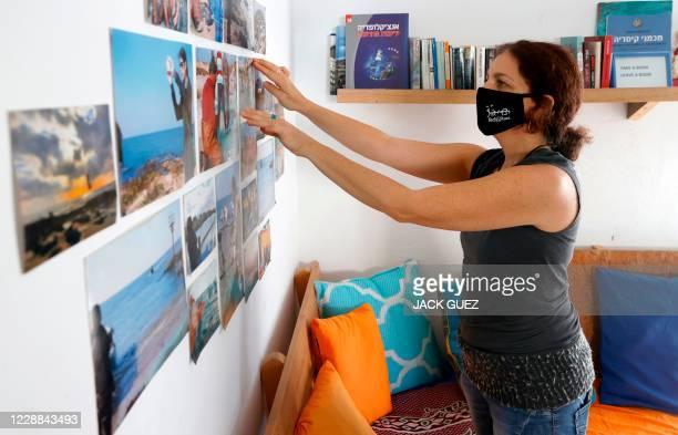 "Israeli Naama Goldman-Shwartz prepares a room for guests at Juha's Guesthouse that she runs with Arab Ahmad ""Juha"" Jorban , in the coastal village of..."