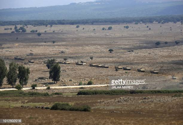 Israeli Namer armoured personnel carriers are seen during a military exercise in the Israeli annexedGolan Heights near the Syrian border on August 7...