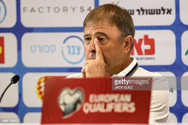 Israeli national football team's head coach, Elisha Levy gestures during a press conference, on September 4, 2016 at Sammy Ofer Stadium in Haifa, in...