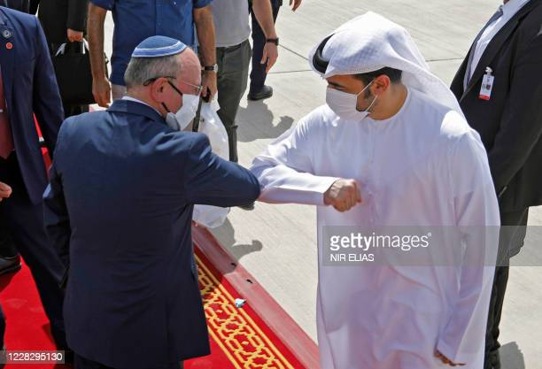Israeli National Security Advisor Meir Ben-Shabbat elbow bumps with an Emirati official ahead of boarding the plane before leaving Abu Dhabi, United...