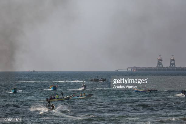 Israeli Naval Forces intervene Palestinian demonstrators sailing with 50 boats from Beit Lahia to protest against the Israeli blockade in Beit Lahia,...