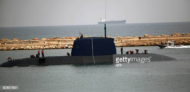 Israeli Navy sailors stand on top of their submarine near the USS HIGGINS destroyer at the Israeli Mediterranean port of Haifa as part of the Juniper...