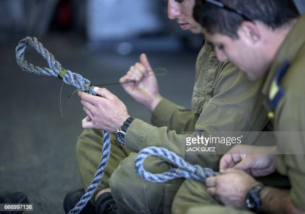 """Israeli officers onboard the Israeli vessel Saar 5 Class Corvette """"INS Hanit"""" practice new rope-nodes during the """"Novel Dina 17"""" training session in..."""
