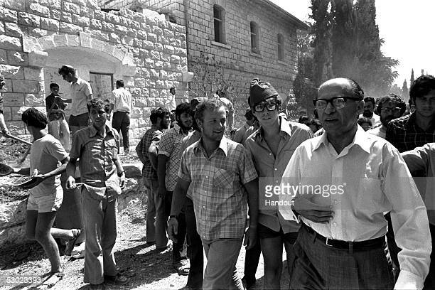 Israeli opposition leader and Likud party head Menachem Begin, R, arrives to join right-wing Jewish settlers who have fenced in the old railway...