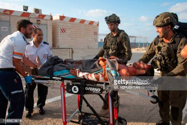 TOPSHOT Israeli paramedics and soldiers evacuate a mock wounded comrade at a helipad in Ramban hospital in the Mediterranean city of Haifa on...
